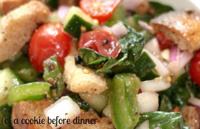 Perfect panzanella featuring garden fresh cucumbers, green peppers, and tomatoes.