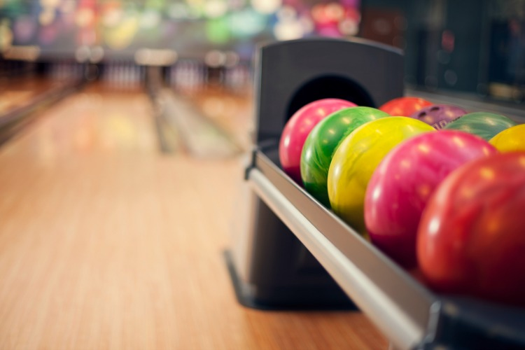Kids bowl free in MA. This blog post is a listing of all of the places your kid can bowl for free this summer.