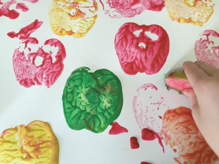 Apple stamping preschool art activity.